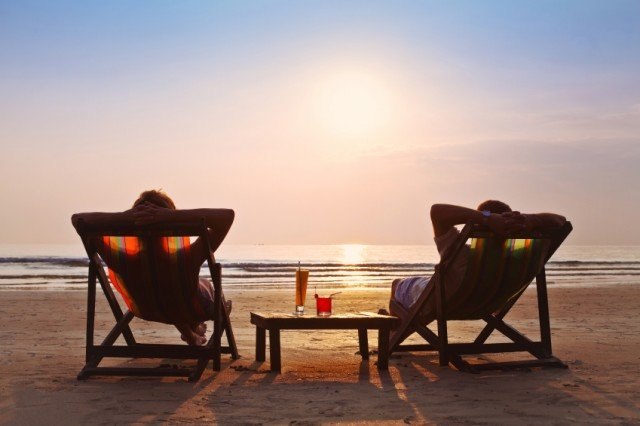 couple lounging in beach chairs
