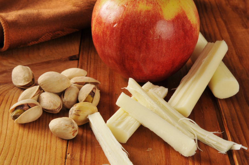 Apples and string cheese on a wooden table