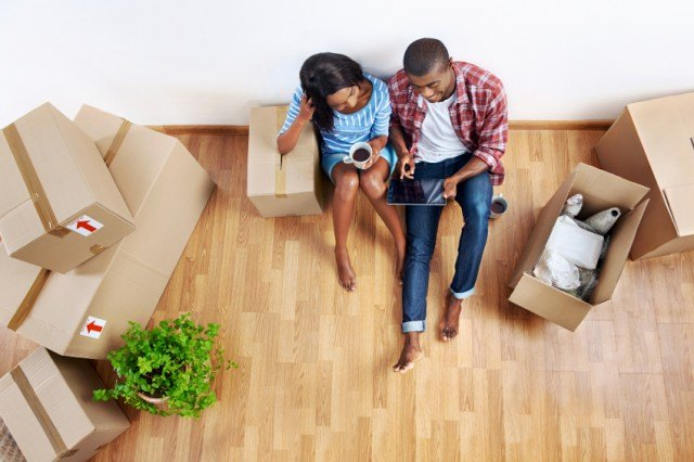 young couple surrounded by boxes