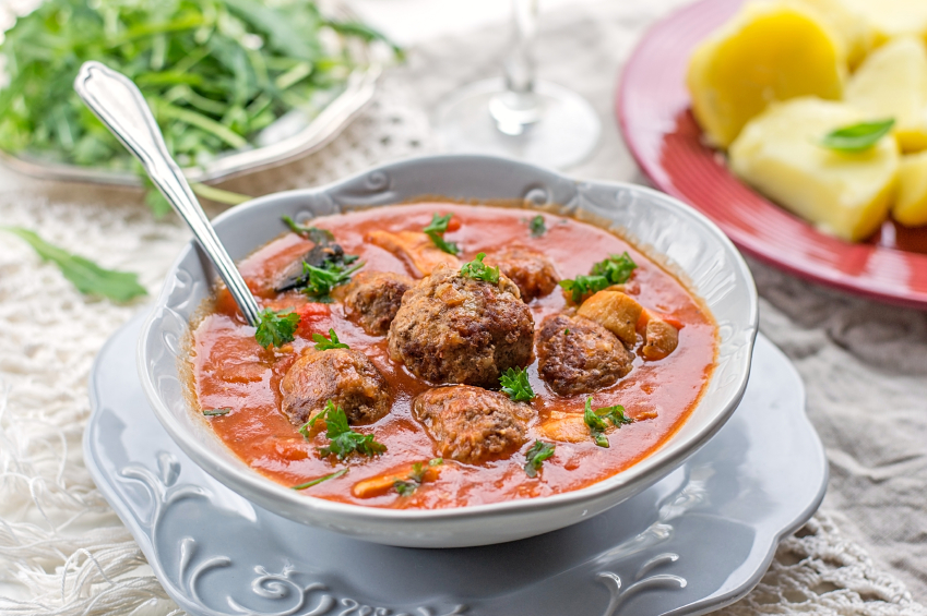 Meatball soup in a tomato broth