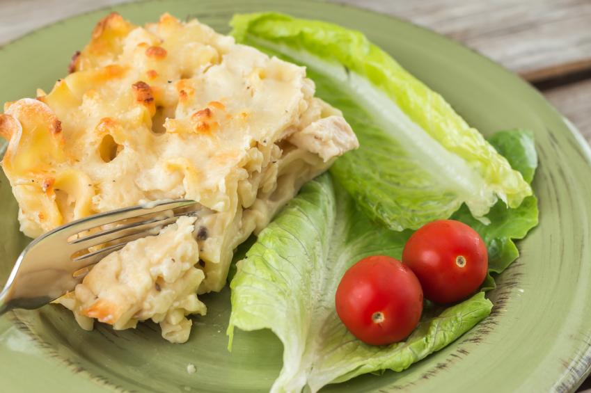 Fresh lasagna with salad