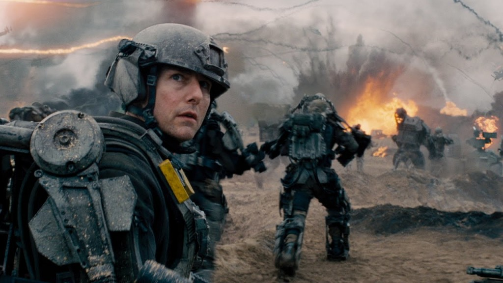 Tom Cruise wears a helmet and armor while in battle in Edge of Tomorrow