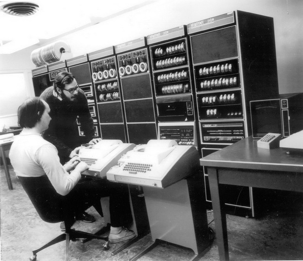 Ken Thompson and Dennis Ritchie (standing) at Bell Labs