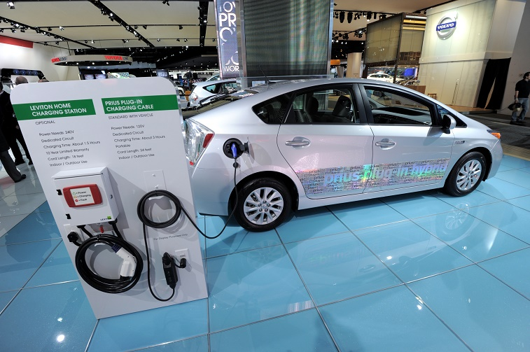 Toyota Prius plug-in hybrid car with model of a home charging station on display during the second press preview day at the 2012 North American International Auto Show January 10, 2012 in Detroit, Michigan.