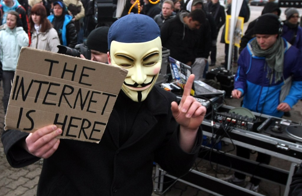 An activist in a Guy Fawkes mask dances in front of a DJ during a demonstration against the Anti-Counterfeiting Trade Agreement (ACTA) on February 25, 2012 in Berlin, Germany. ACTA is a proposed treaty attempting to establish an international governing body with legal standards intended to protect intellectual property and prevent the production and sale of counterfeit goods. The German government has delayed a decision on the agreement, citing concerns by the Justice Ministry, and according to news reports is waiting for approval by the European Parliament prior to signing the multinational treaty. (Photo by Adam Berry/Getty Images)