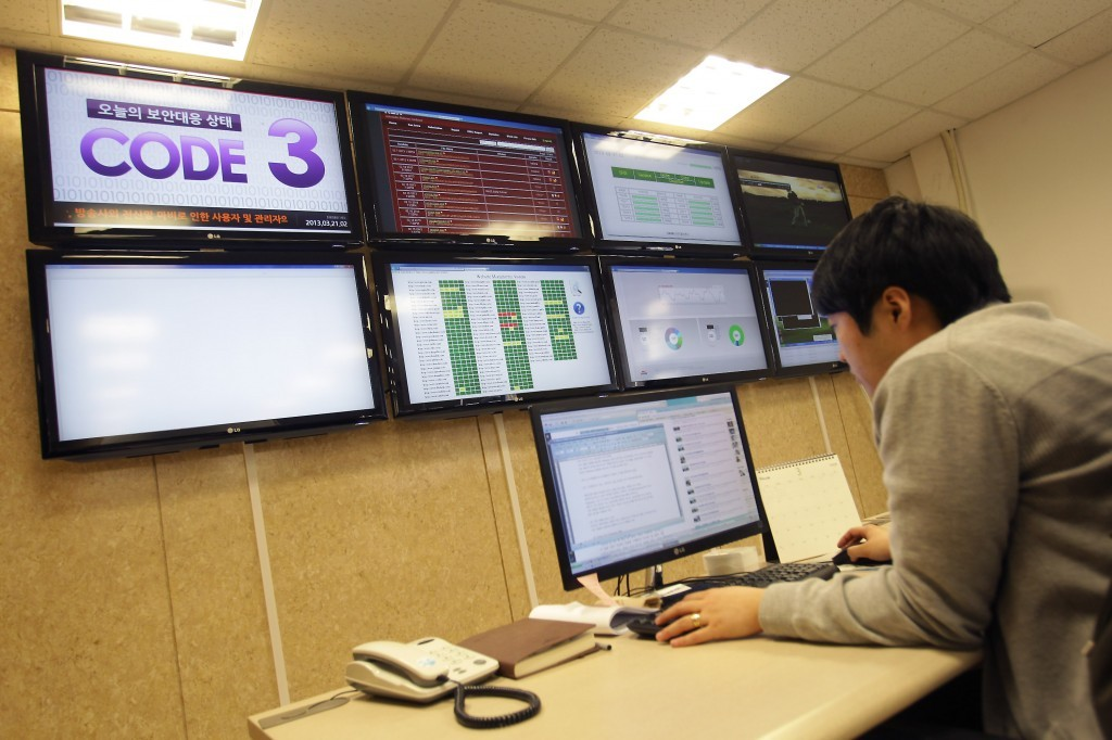 A researcher inspecting for computer viruses at Hauri Inc. the IT security software vendor on March 21, 2013 in Seoul, South Korea. A cyber attack on the computer networks that run three South Korean banks, two broadcasters and an internet service provider in South Korea yesterday has been traced to an IP address in China, despite many experts suspecting the attacks to originate in North Korea. Officials noted that while the attack was traced to an IP address it China may have originated elsewhere and been routed through the country to disguise the attackers. (Photo by Chung Sung-Jun/Getty Images)