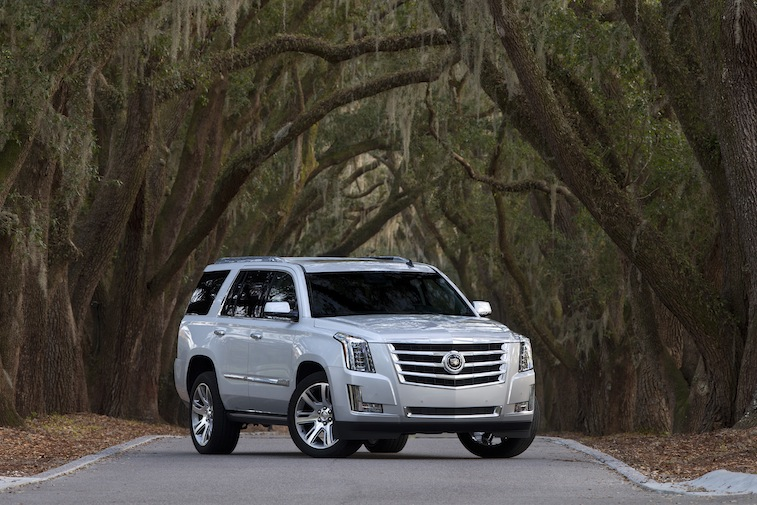Front three-quarter view of white 2015 Cadillac Escalade from passenger side