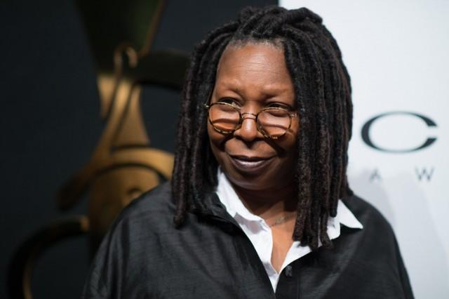 Whoopi Goldberg smiling while at an event.