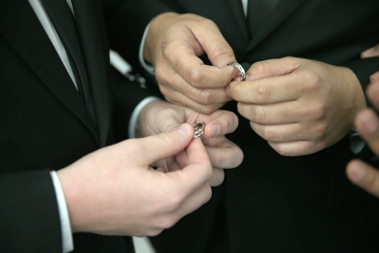 A couple exchanges rings during a wedding ceremony