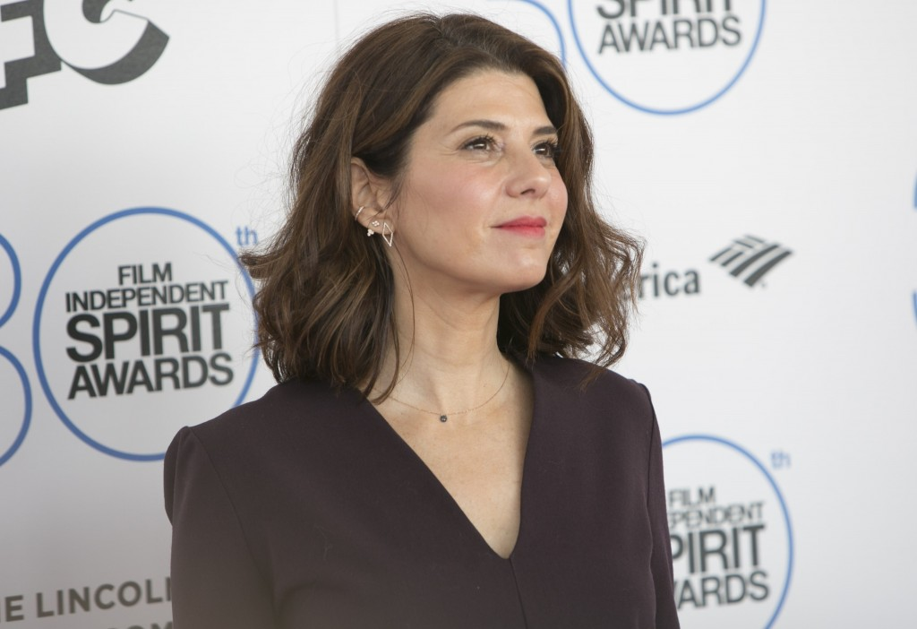 Marisa Tomei on the red carpet in a black blouse