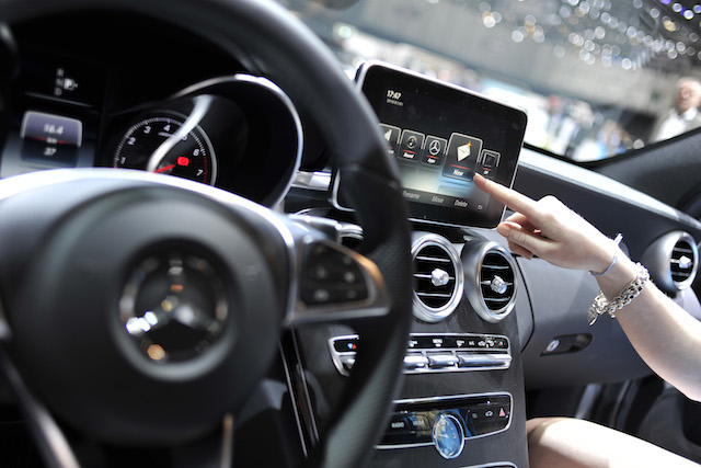 An Apple CarPlay screen is seen in a Mercedes-Benz car