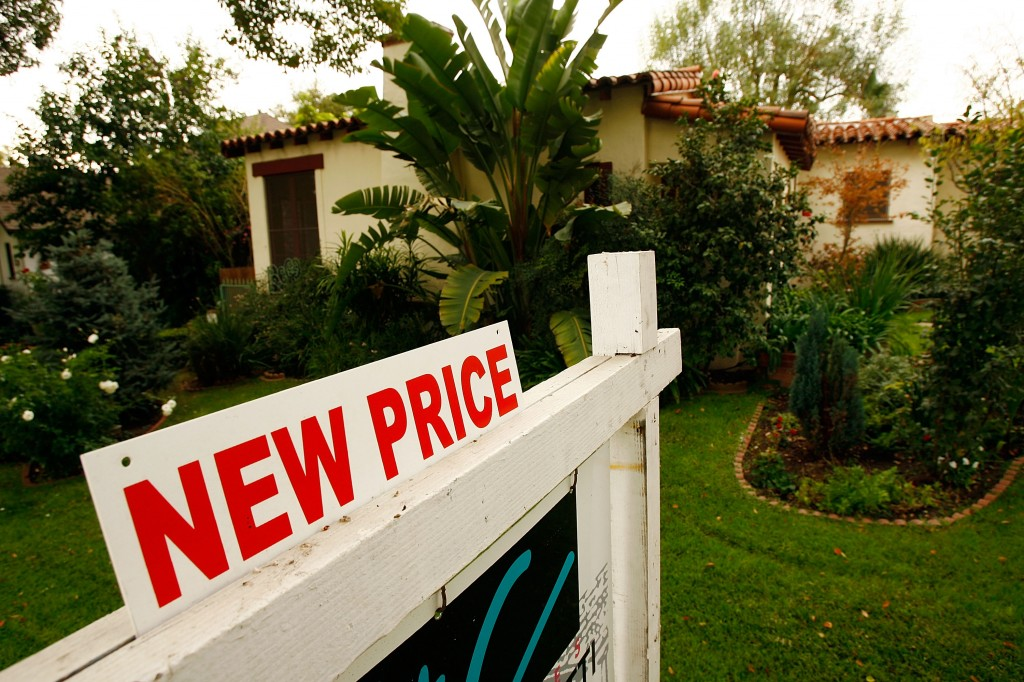 new price sign in front of home