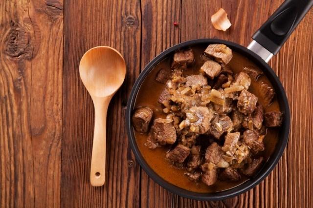 Beef stew - wooden background