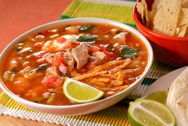 Chicken tortilla soup with lime wedges