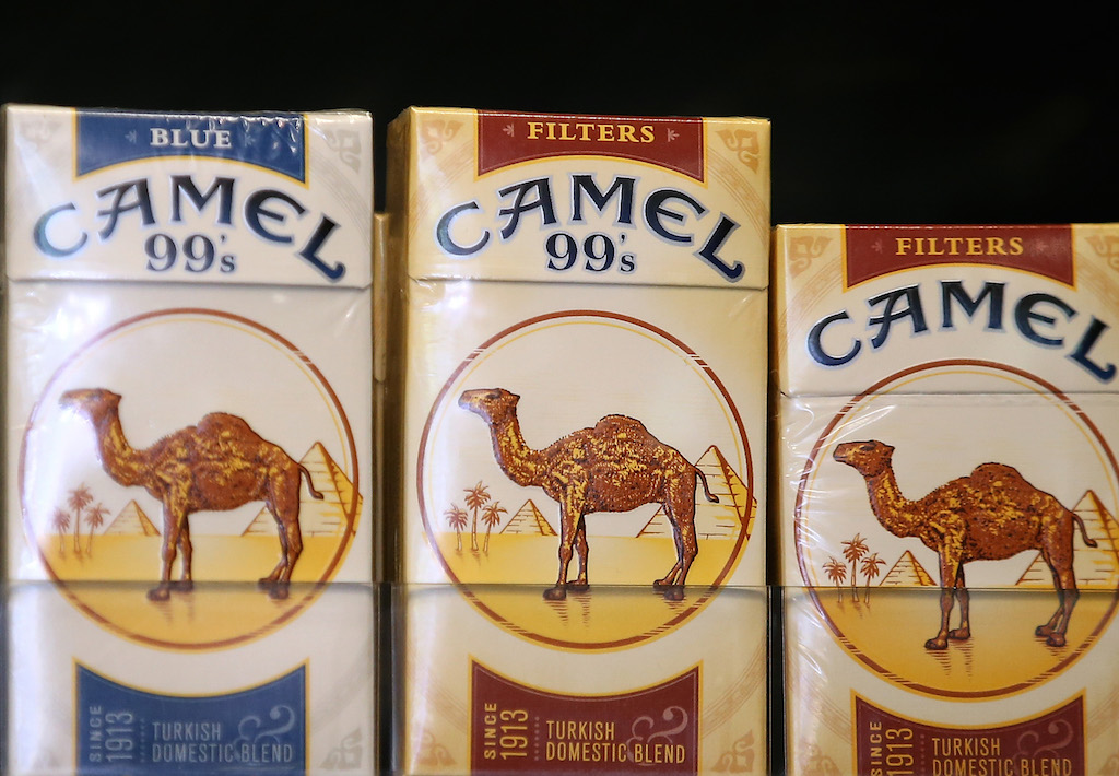 Camel cigarettes, manufactured by Reynolds Amercian, are displayed at a tobacco shop on July 11, 2014 in San Francisco, California. Tobacco giant Reynolds American is reportedly in talks with rival Lorillard Inc. in what is expected to be a multi-billion dollar deal. (Photo by Justin Sullivan/Getty Images)