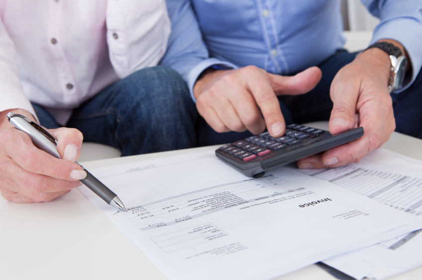 couple looking at forms using calculator