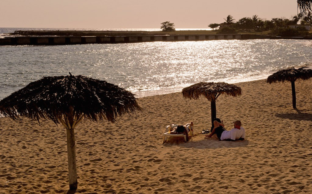Cubans sunbath at Playa Giron beach, in the Bay of Pigs, Matanzas province, Cuba, on April 17, 2011. Playa Giron was one of the beaches where the invaders disembarked on April 1961. (Photo by Adalberto Roque/AFP/Getty Images)