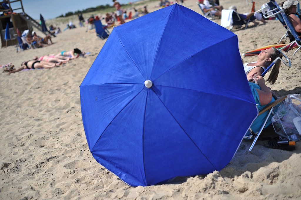 People relax on the beach at Cape Henlopen, Delaware