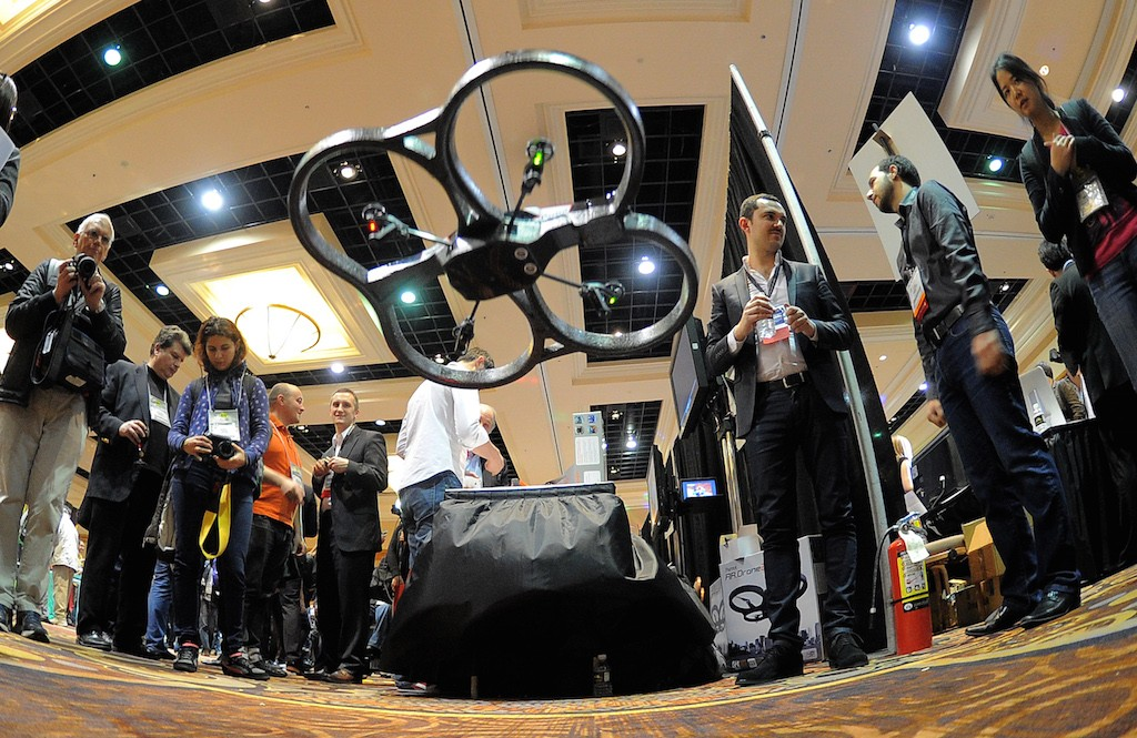 French Parrot introduces their automatic 4 rottor flying drones during the opening event ''CES Unveiled'' during the International Consumer Electronics Show (CES) in Mandalay Bay Hotel resort on January 06, 2013 in Las Vegas, Nevada. (Photo by Joe Klamar/AFP/Getty Images)