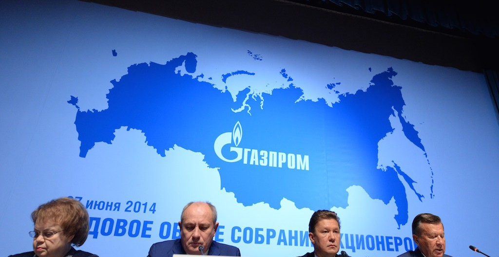 Russia's gas giant Gazprom CEO, Alexei Miller (2nd R), and Gazprom's board of directors chairman, Viktor Zubkov (R), attend the world biggest gas company's annual meeting in Moscow, on June 27, 2014, with the logo of Gazprom in the background. The Russia's map in the background includes the Crimea peninsula. Crimea's largely Russian-speaking residents voted in March to become part of Russia, in a hastily organised referendum held as Russian troops patrolled the region. Photo by Vasily Maximov/AFP/Getty Images.