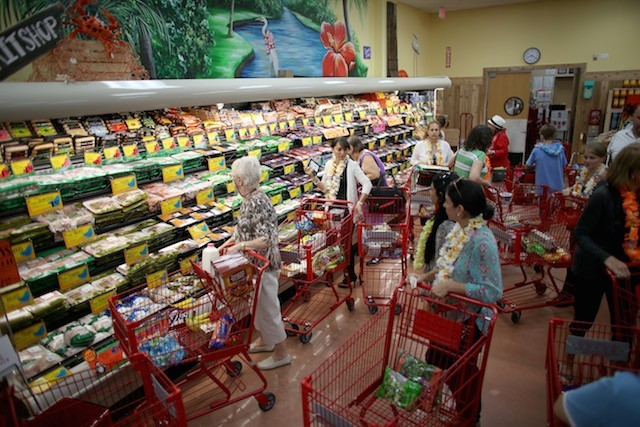 A busy Trader Joe's full of customers.
