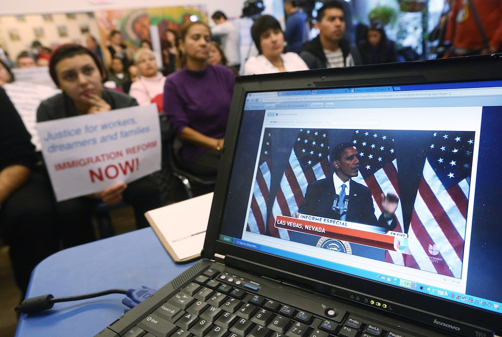U.S. President Barack Obama's speech on immigration is played on a computer screen during a watch party held by an immigrant rights group on January 29, 2013 in the Queens borough of New York City. Obama called for immigration reform and a 'pathway to citizenship' for the nation's 11 million undocumented immigrants. (Photo by Mario Tama/Getty Images)