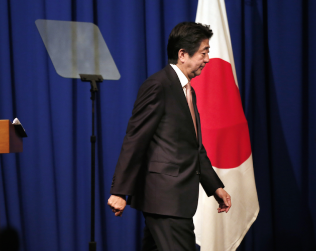Shinzo Abe walks off stage at a press conference