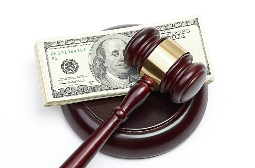 A gavel and cash