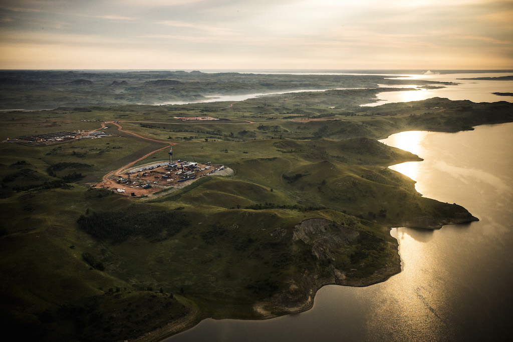 An oil drilling rig is seen in an aerial view in the early morning hours of July 30, 2013 near Bismarck, North Dakota. The state has seen a boom in oil production thanks to new drilling techniques including horizontal drilling and hydraulic fracturing. (Photo by Andrew Burton/Getty Images)