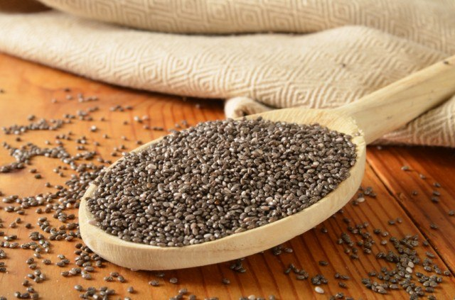 large wooden spoon filled with chia seeds