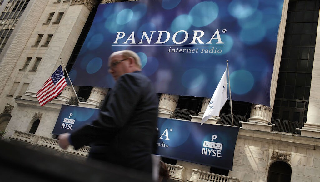 A banner for Pandora Media Inc., the online-radio company, hangs in front of the New York Stock Exchange walk on its first day of trading as a public company on June 15, 2011 in New York City. (Photo by Spencer Platt/Getty Images)