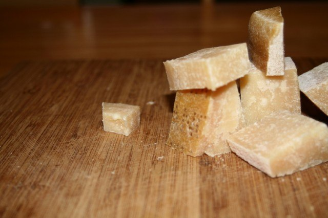 blocks of Parmesan cheese to be grated