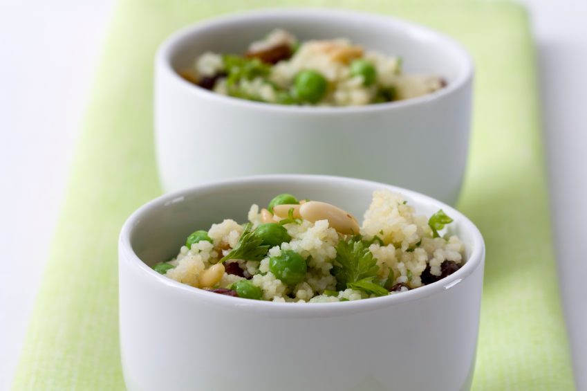 spring vegetables in two white bowls