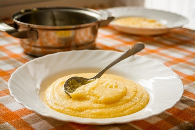 creamy polenta in a wide-rimmed white bowl