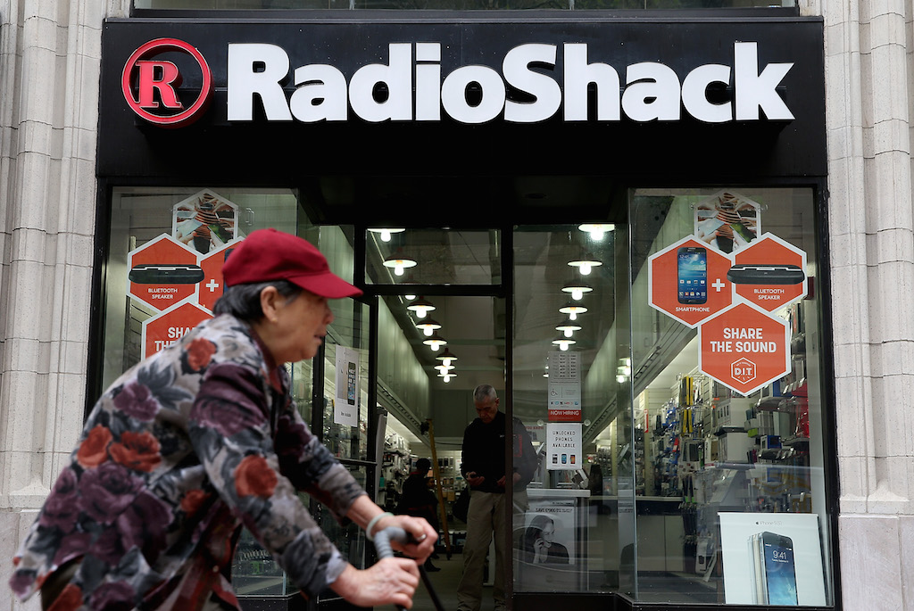 A person rides by a Radio Shack store on March 4, 2014 in San Francisco, California. RadioShack announced plans to close over 1,000 of its underperforming stores, approximately 20 percent of its retail locations, as part of a restructuring to be more competitive in retail electronics. (Photo by Justin Sullivan/Getty Images)