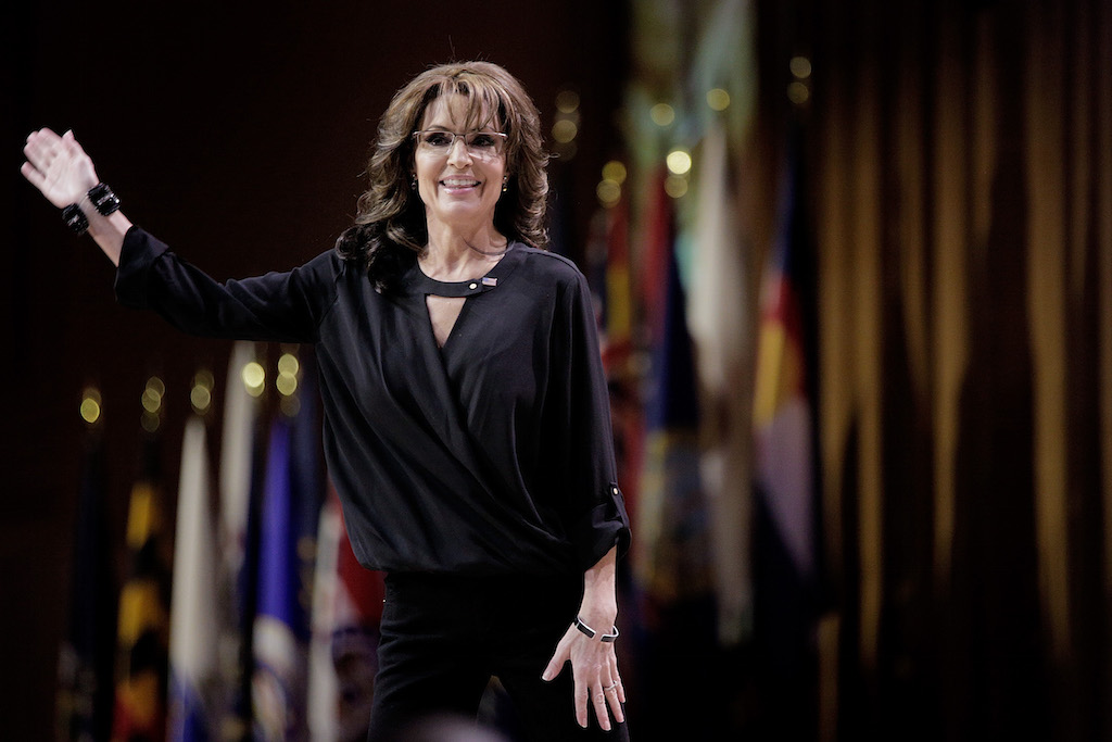 Conservative pundit, television personality and former vice presidential candidate Sarah Palin waves as she leaves the stage during the 41st annual Conservative Political Action Conference at the Gaylord International Hotel and Conference Center on March 8, 2014 in National Harbor, Maryland. The conference, a project of the American Conservative Union, brings together conservative polticians, pundits and voters for three days of speeches and workshops. (Photo by T.J. Kirkpatrick/Getty Images)