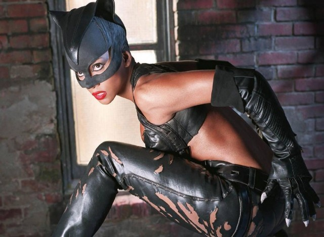 Halle Berry crouches down while wearing a Catwoman suit