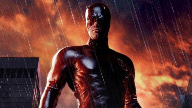Ben Affleck wears the Daredevil costume while standing in the rain