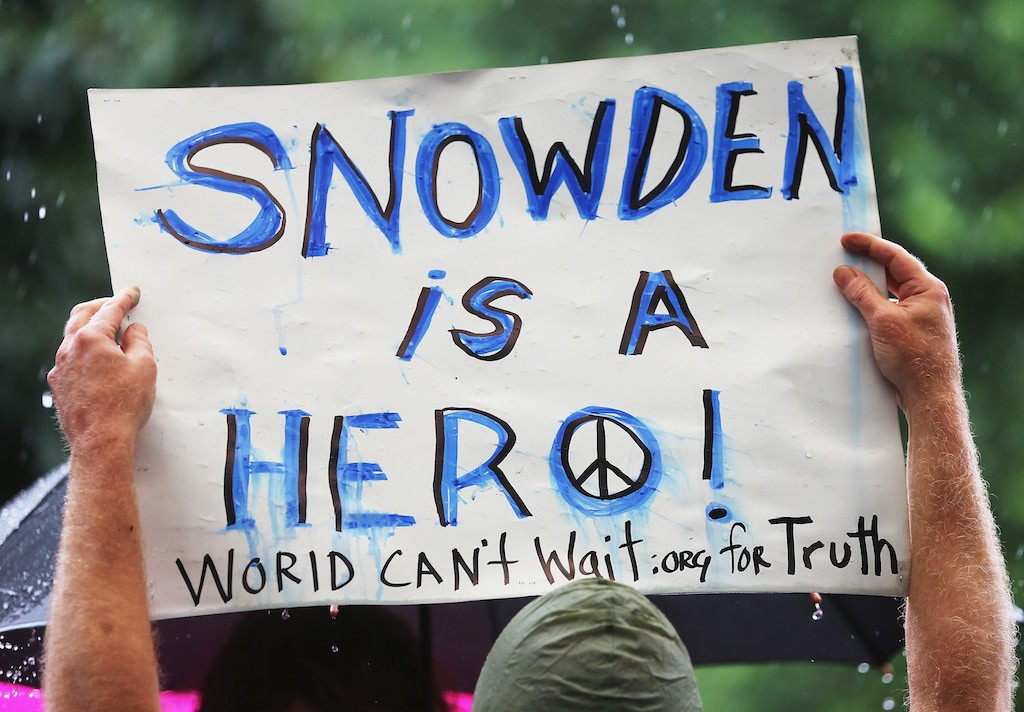 A supporter holds a sign at a small rally in support of National Security Administration (NSA) whistleblower Edward Snowden in Manhattan's Union Square on June 10, 2013 in New York City. About 15 supporters attended the rally a day after Snowden's identity was revealed in the leak of the existence of NSA data mining operations. (Photo by Mario Tama/Getty Images)