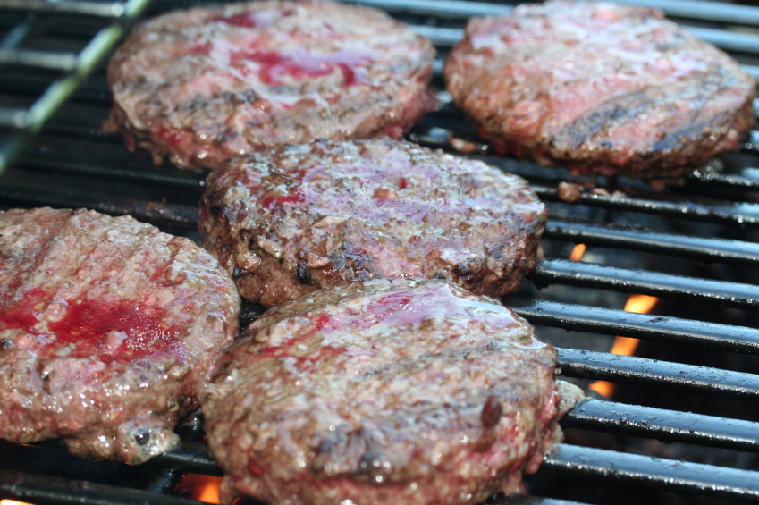 Burgers cooking on a grill