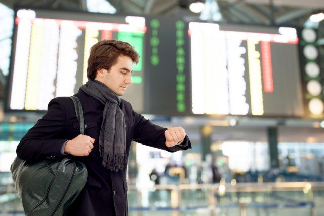 Man wearing a scarf while traveling