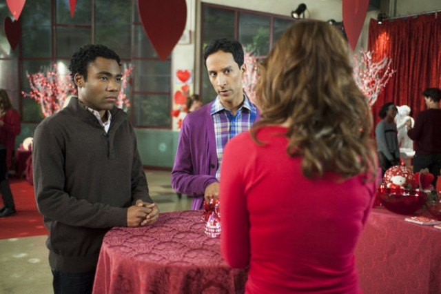 'Community' characters mingling at a Valentine's Day party.