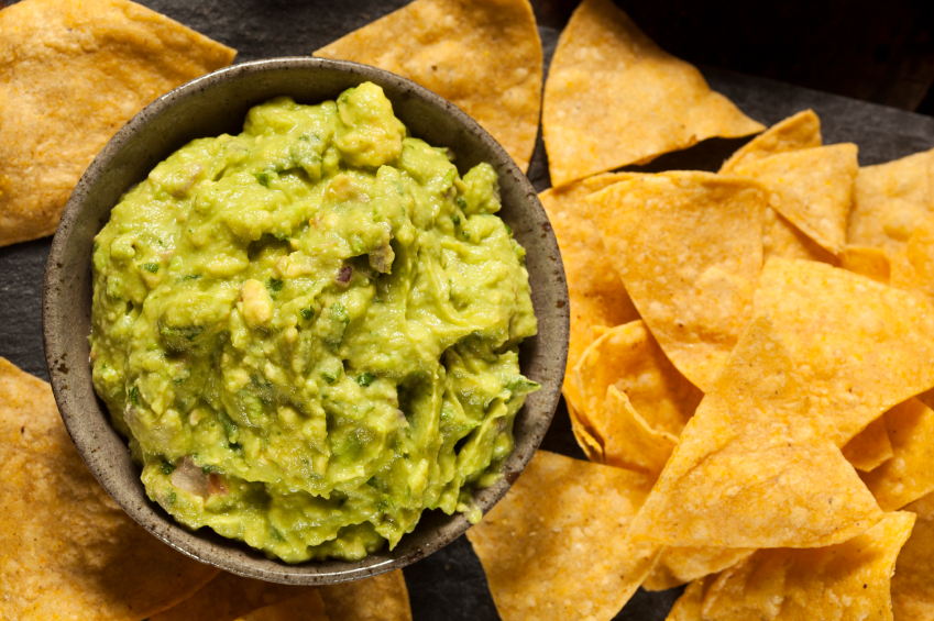 Green guacamole with tortilla chips