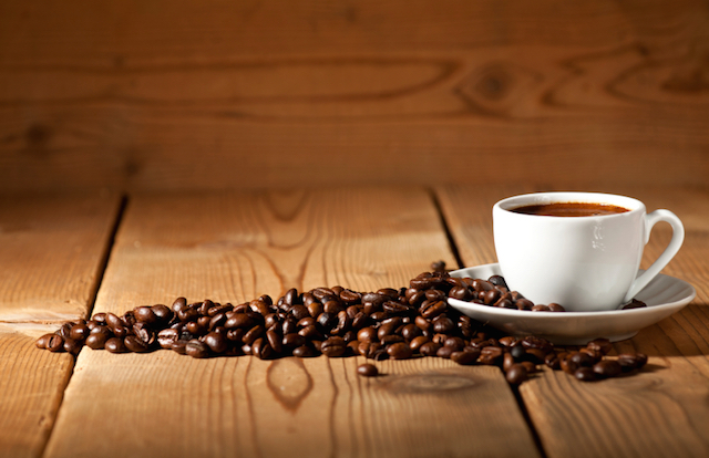 Fresh cup of coffee with coffee beans