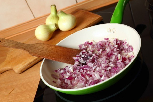 Onions cooking in a pan