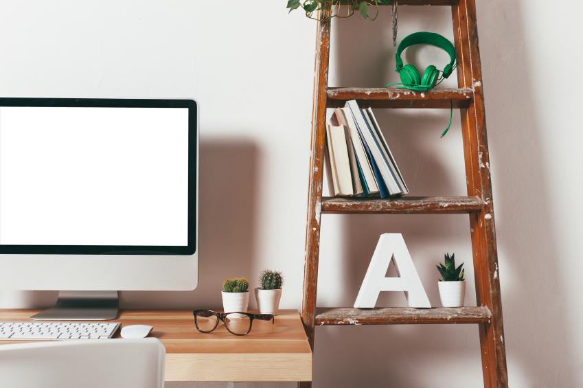 a workspace computer and a ladder shelf