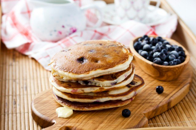 towering pile of blueberry pancakes