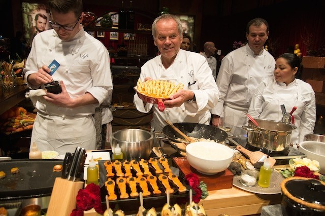 Wolfgang Puck cooking with other chefs