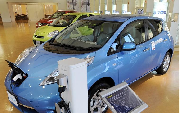 A Nissan Leaf electric vehicle is displa
