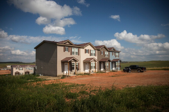 New townhouses are seen next to a highway in Watford City, North Dakota